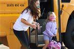 An HME student exits the bus on the first day of the 2020 school year.