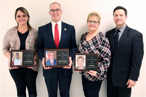 Photo of CSSd Wall of Distinction inductees Ken Robarge, Mark Walczyk and Lori Wood with Superintendent Thomas J. Colabufo